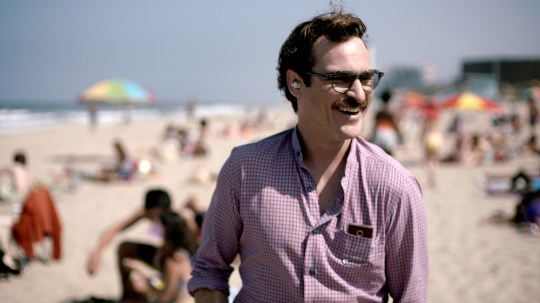 Joaquin Phoenix gets to romance Philip Seymour Hoffman in the spoof trailer for Her (Picture: Warner Bros)