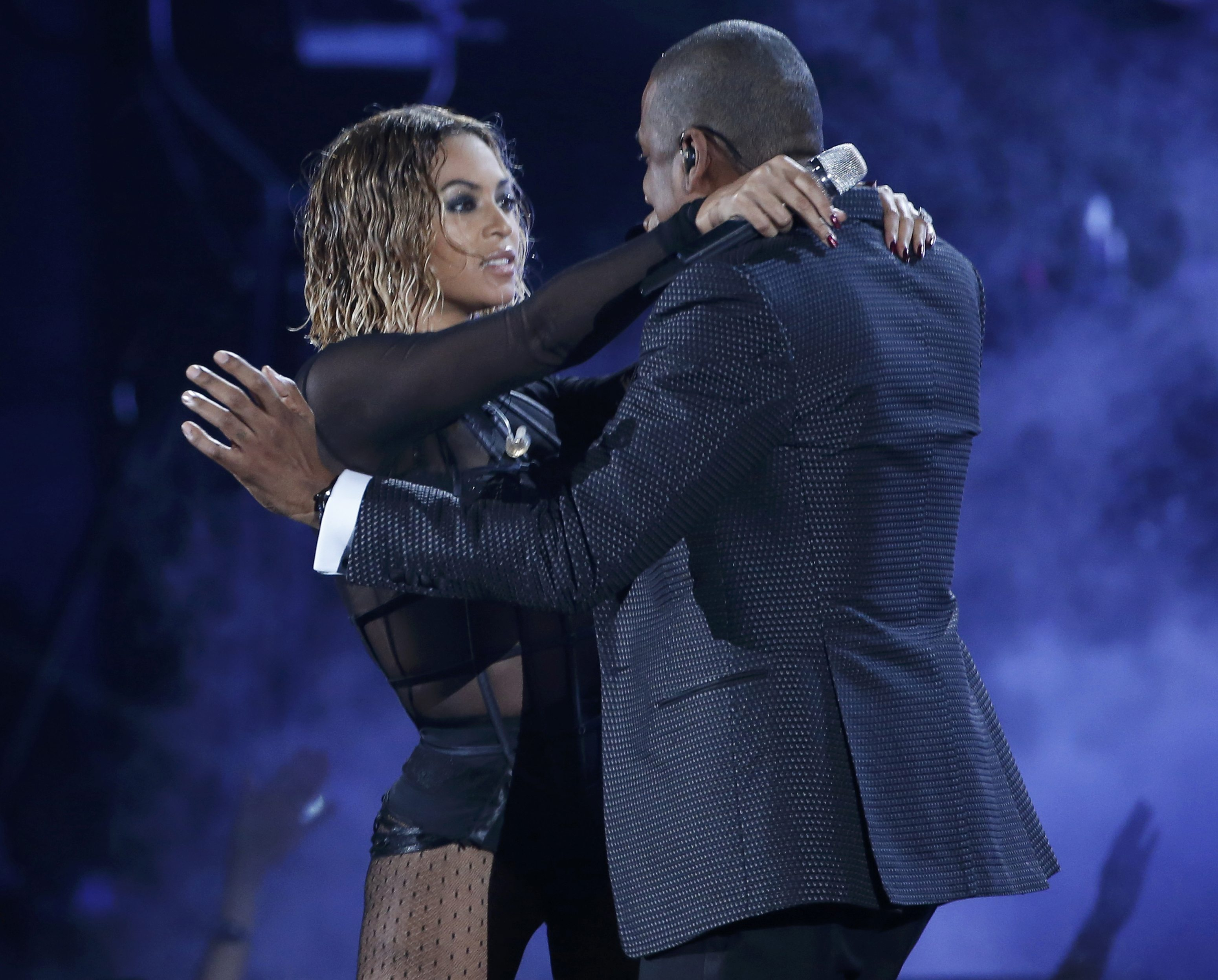 Beyonce embraces husband Jay Z during their steamy performance at the Grammys (Picture: Reuters)