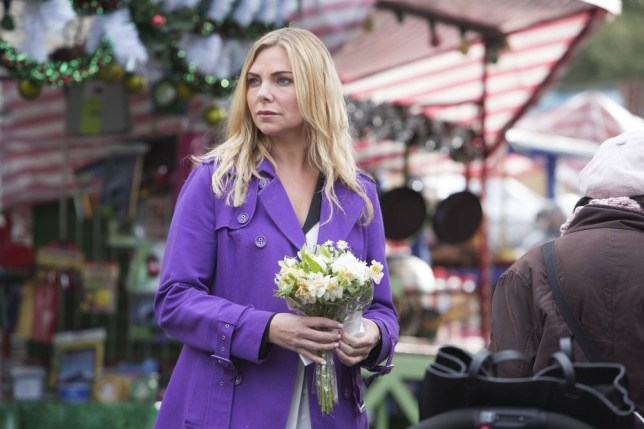 Programme Name: EastEnders - TX: 31/12/2013 - Episode: n/a (No. 4774) - Embargoed for publication until: 07/12/2013 - Picture Shows: Ronnie buys a white posy in remembrance of baby James. Ronnie Mitchell (SAMANTHA WOMACK) - (C) BBC - Photographer: Gary Moyes