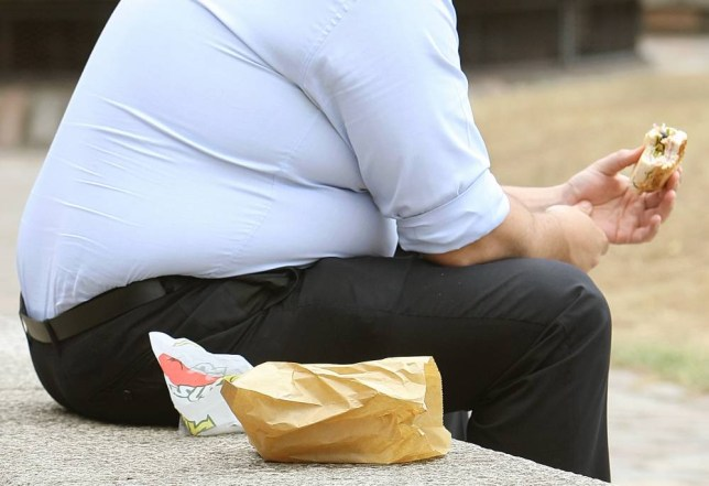 File photo dated 28/07/10 of an overweight man eating fast food. More than a third of all adults across the world are overweight or obese, a report from a UK think-tank has revealed, leading to calls for governments to do more to tackle the growing crisis.  PRESS ASSOCIATION Photo. Issue date: Friday January 3, 2014. See PA story HEALTH Obesity. Photo credit should read: Dominic Lipinski/PA Wire