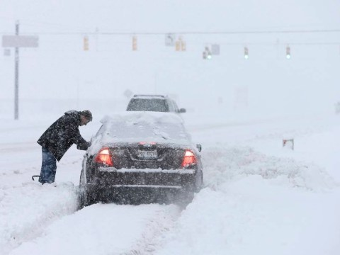 Killer freeze grips the US: Polar vortex and gusts combine to create 'life-threatening wind chill' of -51C