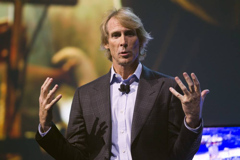 Hollywood director Michael Bay speaks during a Samsung Electronics news conference during the Consumer Electronics Show (CES), in Las Vegas, Nevada, January 6, 2014. REUTERS/Steve Marcus (UNITED STATES - Tags: BUSINESS SCIENCE TECHNOLOGY ENTERTAINMENT)