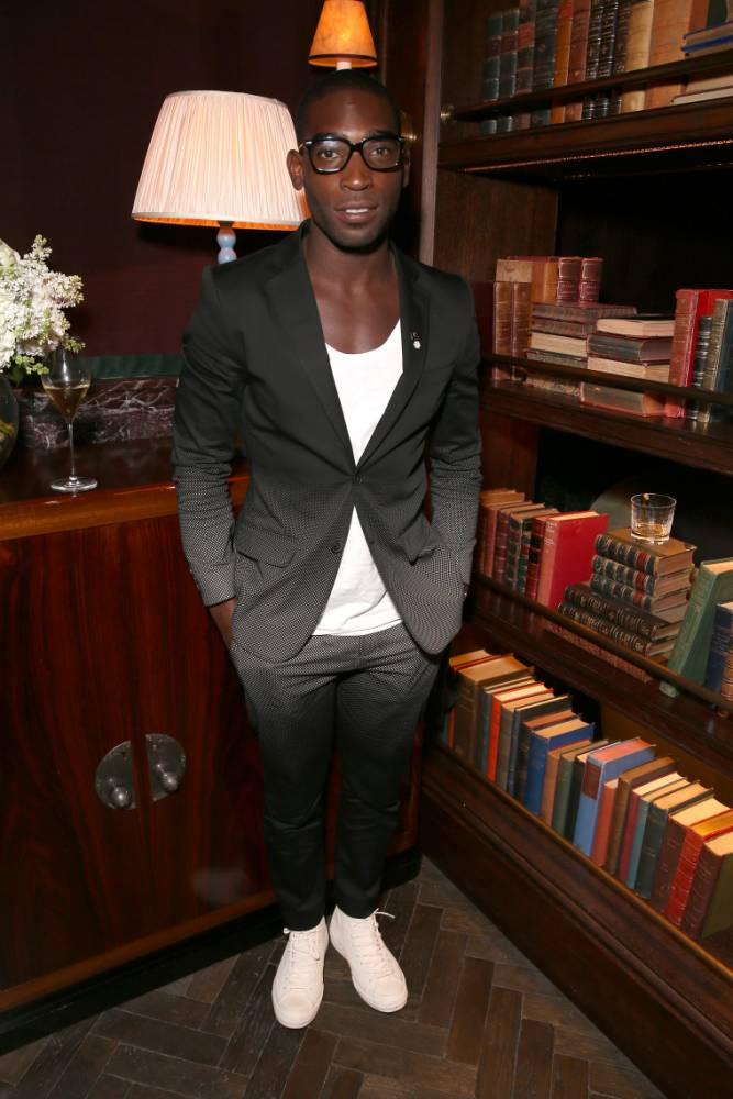 LONDON, ENGLAND - JANUARY 06:  Singer Tinie Tempah poses at The Esquire London Collections: Men opening night party at Rosewood London on January 6, 2014 in London, England.  (Photo by Mike Marsland/WireImage) *** Local Caption *** Tinie Tempah