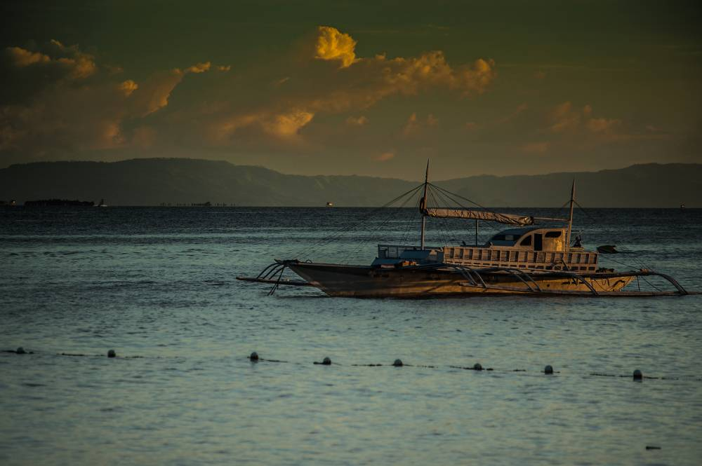 Travel to The Philippines, it's open for business for feasting, diving and walking
