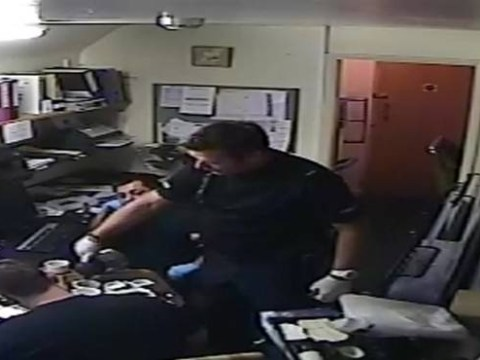 Caught on camera: Police drink coffee and biscuits while searching suspect's office as he waits in jail