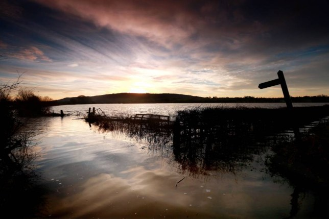 The sunrises over the flooded fields around Eckington in Worcestershire. PRESS ASSOCIATION Photo. Picture date: Friday January 10, 2014. Photo credit should read: David Davies/PA Wire