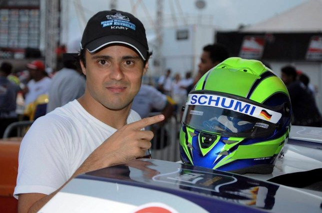 """Former Ferrari Formula One driver Felipe Massa of Brazil points to his helmet painted with the nickname """"Schumi"""" as a tribute to Michael Schumacher, before competing in a karting race International Challenge of the Stars in this handout picture in Penha January 11, 2014. Schumacher, a seven-times Formula One champion who retired in 2012, is in a critical condition with brain injuries. The German has been in an induced coma since then and has undergone two operations in Grenoble since December 29, 2013. REUTERS/Duda Barrios/Handout via Reuters (BRAZIl - Tags: SPORT TRANSPORT MOTORSPORT F1) ATTENTION EDITORS - NO SALES. NO ARCHIVES. FOR EDITORIAL USE ONLY. NOT FOR SALE FOR MARKETING OR ADVERTISING CAMPAIGNS. THIS IMAGE HAS BEEN SUPPLIED BY A THIRD PARTY. IT IS DISTRIBUTED, EXACTLY AS RECEIVED BY REUTERS, AS A SERVICE TO CLIENTS"""