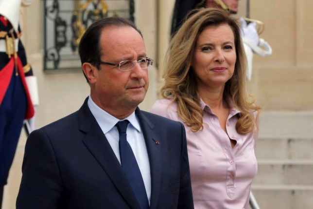 "French President Francois Hollande (L) and first lady Valerie Trierweiler accompany guests following a meeting at the Elysee Palace in Paris in this October 1, 2013 file photo. Trierweiler's spokesman confirmed on January 12, 2014 that she had been admitted to hospital in Paris needing ""rest"", but said would be discharged on Monday. The daily newspaper Le Parisien said earlier on Sunday that Trierweiler had been taken to hospital after being shaken by reports of an affair between her partner Hollande, and an actress.     REUTERS/Philippe Wojazer/Files  (FRANCE - Tags: POLITICS ENTERTAINMENT SOCIETY HEALTH)"