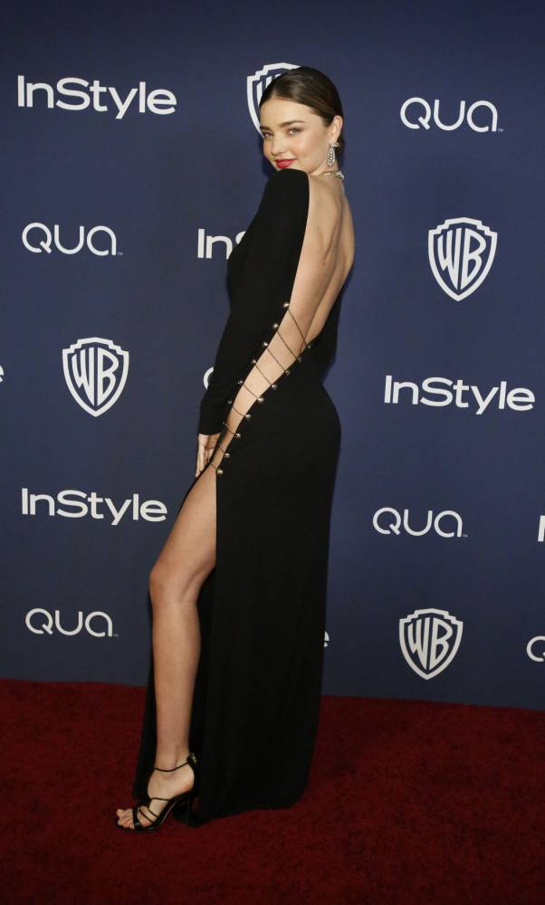 Model Miranda Kerr poses at the 15th annual Warner Bros. and InStyle after party, after the 71st annual Golden Globe Awards in Beverly Hills, California January 12, 2014. REUTERS/Mario Anzuoni (UNITED STATES - Tags: ENTERTAINMENT) (GOLDENGLOBES-PARTIES)