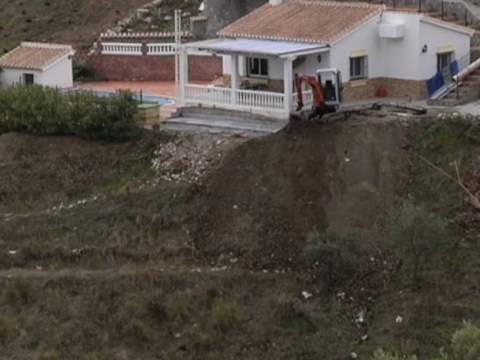 Father killed in mudslide while trying to fix up holiday home