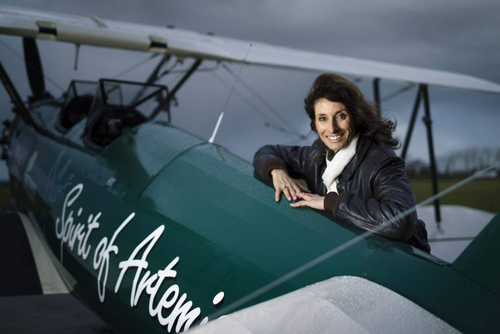 Weeks in an open cockpit: Pilot recreates historic solo flight across Africa in her 1940s biplane
