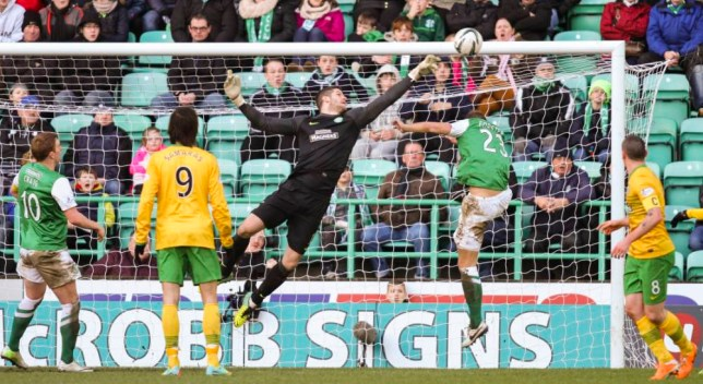 26.01.2014 Edinburgh, Scotland. Fraser Forster keeps another clean sheet in goal during the Scottish Premier League game between Hibernian and Celtic from Easter Road.