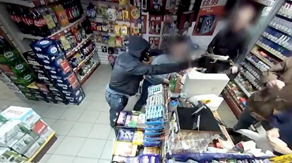 Shopkeeper filmed fighting off gunman wearing V For Vendetta mask
