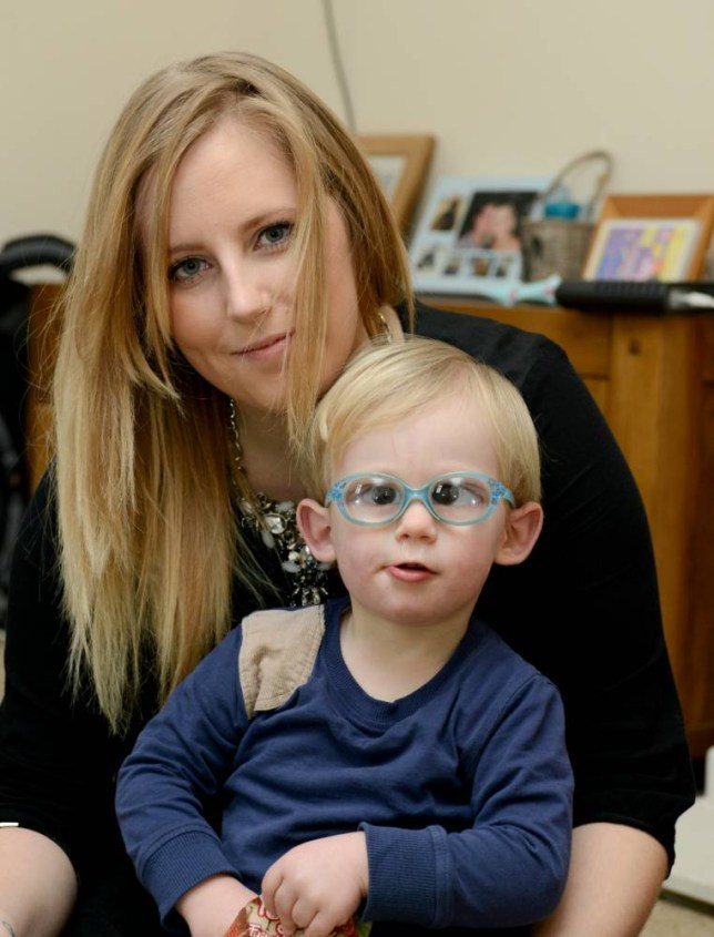 """Aneliese Whittaker with her son Logan Kelly.  Supermarket giant Tesco has removed a range of clothes featuring pictures of animals wearing spectacles and the words 'nerd' and 'geek' after a mum complained they would cause her toddler son with eye problems to be BULLIED. See swns story SWGEEK. Angry Aneliese Whittaker, 28, launched a campaign demanding the t-shirts be pulled from sale claiming they """"stereotype"""" people who wear glasses - including 18-month-old Logan. Cute Logan was born with dense cataracts in both eyes and wears thick """"goggle-like"""" blue-rimmed specs with powerful prescription lenses. Aneliese says she was outraged when she saw Tesco selling a range of t-shirts which featured pictures of different animals wearing glasses - and the words 'geek' or 'nerd' underneath. She said the design would see her son and other visually-impaired youngsters bullied and launched a Facebook campaign demanding their removal from shelves. Tesco has now issued an apology to Aneliese, of Ifield, Surrey, and say they are discontinuing the entire line."""