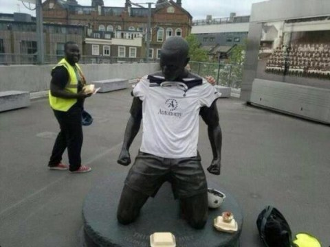 Tottenham fans rile Arsenal by dressing Thierry Henry statue in Spurs shirt