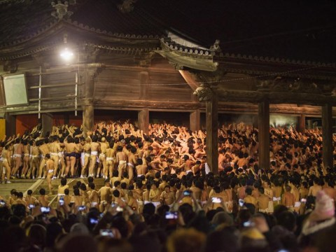 9,000 half-naked men hustle for pair of sacred sticks in Japanese festival