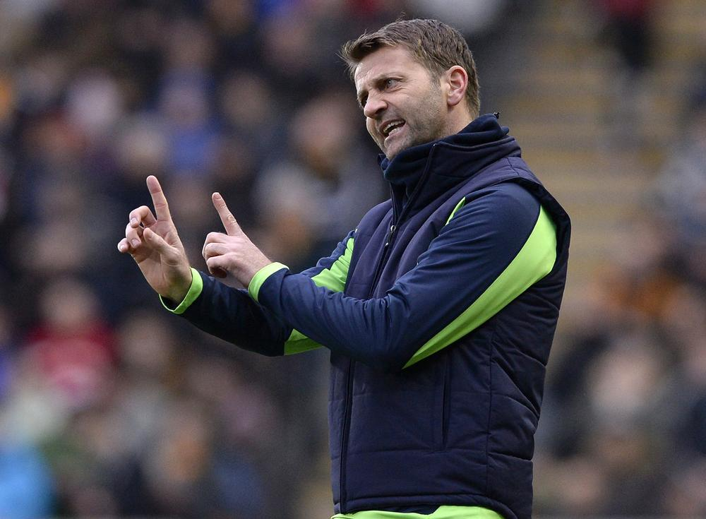 "Tottenham Hotspur's manager Tim Sherwood reacts during their English Premier League soccer match against Hull City at the KC Stadium in Hull, northern England February 1, 2014. REUTERS/Nigel Roddis (BRITAIN - Tags: SPORT SOCCER) FOR EDITORIAL USE ONLY. NOT FOR SALE FOR MARKETING OR ADVERTISING CAMPAIGNS. NO USE WITH UNAUTHORIZED AUDIO, VIDEO, DATA, FIXTURE LISTS, CLUB/LEAGUE LOGOS OR ""LIVE"" SERVICES. ONLINE IN-MATCH USE LIMITED TO 45 IMAGES, NO VIDEO EMULATION. NO USE IN BETTING, GAMES OR SINGLE CLUB/LEAGUE/PLAYER PUBLICATIONS Nigel Roddis/Reuters"
