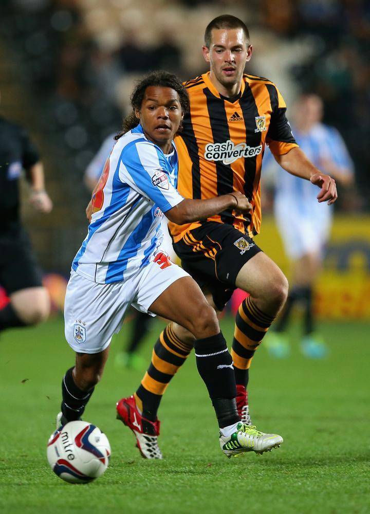 HULL, ENGLAND - SEPTEMBER 24: Matthew Fryatt of Hull City in action with Duane Holmes of Huddersfield Town during the Capital One Cup third round match between Hull City and Huddersfield Town at the KC Stadium on September 24, 2013 in Hull, England. Julian Finney/Getty Images