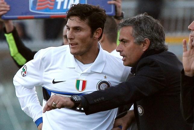 FC Inter's coach Jose Mourinho (R) speak