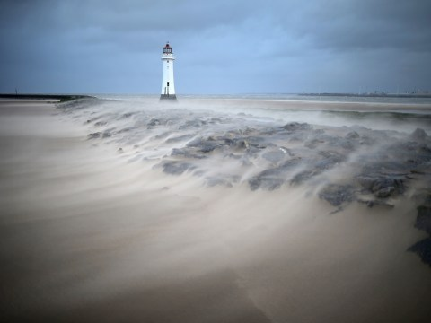 UK weather: Two dead as wild storms and floods batter Britain
