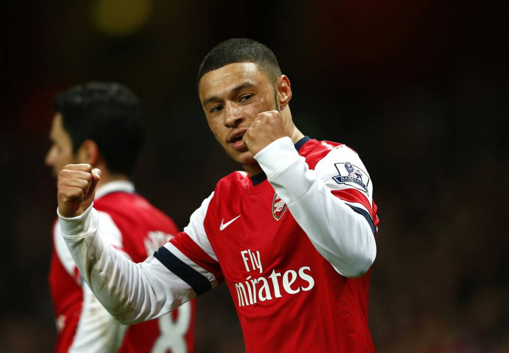 "Arsenal's Alex Oxlade-Chamberlain celebrates after scoring a goal against Crystal Palace during their English Premier League soccer match at the Emirates stadium in London, February 2, 2014.   REUTERS/Eddie Keogh   (BRITAIN - Tags: SPORT SOCCER) FOR EDITORIAL USE ONLY. NOT FOR SALE FOR MARKETING OR ADVERTISING CAMPAIGNS. NO USE WITH UNAUTHORIZED AUDIO, VIDEO, DATA, FIXTURE LISTS, CLUB/LEAGUE LOGOS OR ""LIVE"" SERVICES. ONLINE IN-MATCH USE LIMITED TO 45 IMAGES, NO VIDEO EMULATION. NO USE IN BETTING, GAMES OR SINGLE CLUB/LEAGUE/PLAYER PUBLICATIONS"