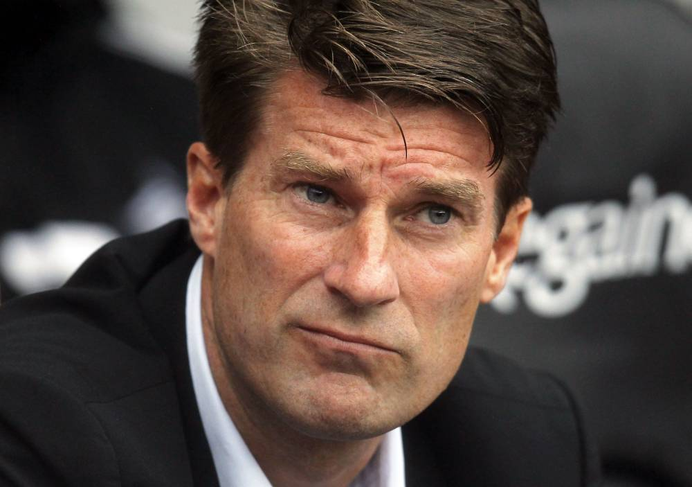 (FILES) In a file picture taken on August 17, 2013 Swansea City's Danish manager Michael Laudrup awaits kick off of the English Premier League football match between Swansea City and Manchester United at Liberty Stadium in Swansea, south Wales. Swansea City have parted company with manager Michael Laudrup, the Premier League club announced on February 4, 2014. AFP PHOTO/IAN KINGTON  RESTRICTED TO EDITORIAL USE. NO USE WITH UNAUTHORIZED AUDIO, VIDEO, DATA, FIXTURE LISTS, CLUB/LEAGUE LOGOS OR LIVE SERVICES. ONLINE IN-MATCH USE LIMITED TO 45 IMAGES, NO VIDEO EMULATION. NO USE IN BETTING, GAMES OR SINGLE CLUB/LEAGUE/PLAYER PUBLICATIONS.IAN KINGTON/AFP/Getty Images