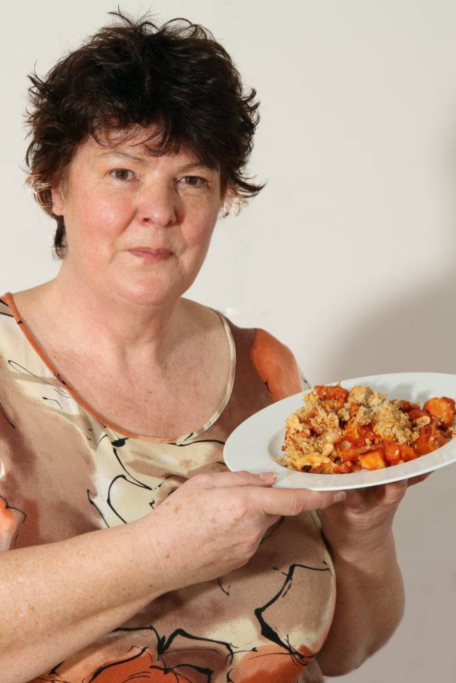 **EXCLUSIVE** Lesley Cooper, 62, at home with her vegetable crumble she makes for only 40p, in Heathfield, East Sussex, UK, Monday 3rd February, 2014. Lesley's meals show how to feed yourself for just £1 a day.