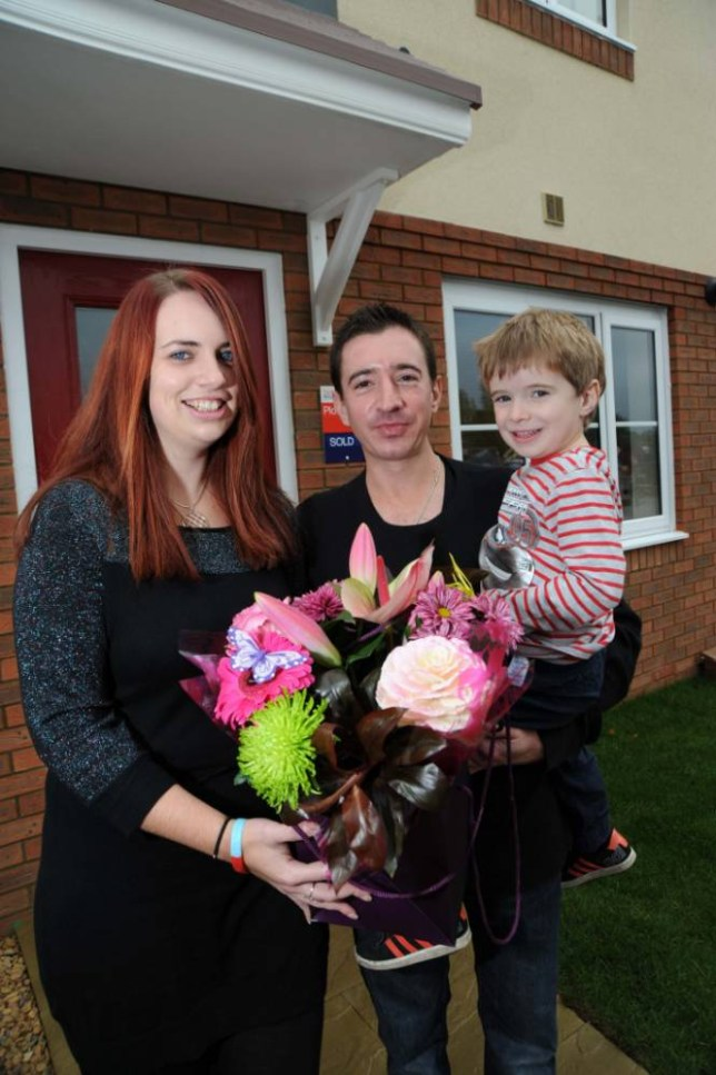Hollie and Neil Lumley with son Ben outside the Luton home they bought with Help to Buy (Picture: supplied)