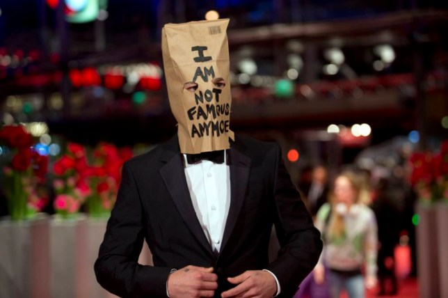 Actor Shia LaBeouf poses for photographers, with a paper bag over his head that says 'I am not famous anymore', on the red carpet for the film Nymphomaniac at the International Film Festival Berlinale in Berlin, Sunday, Feb. 9, 2014. (AP Photo/Axel Schmidt)