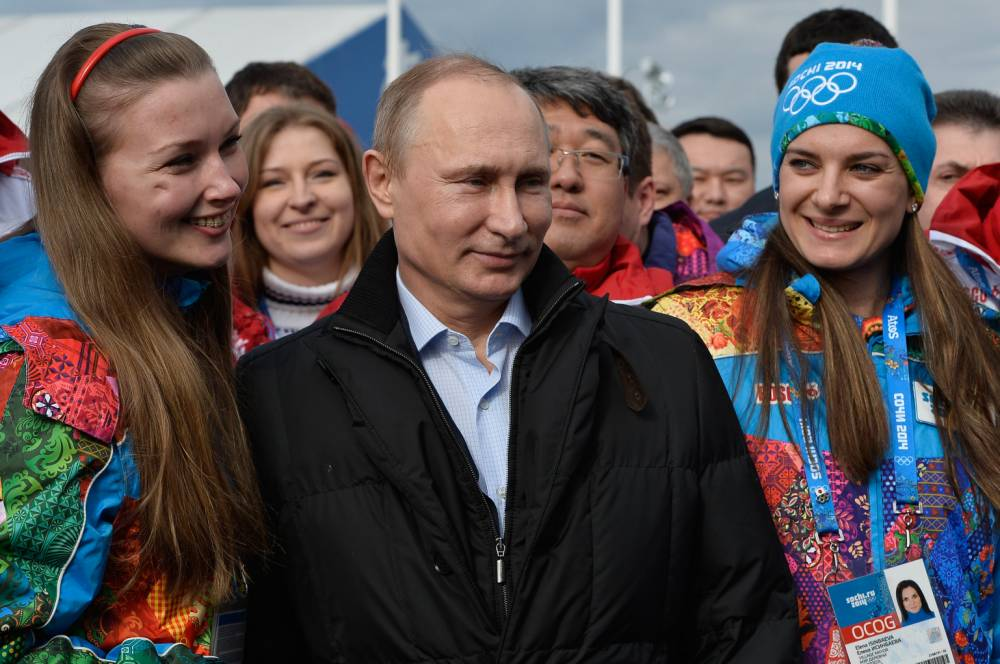 Russian President Vladimir Putin and Olympic Village Mayor Elena Isinbaeva visit the Coastal Cluster Olympic Village ahead of the Sochi 2014 Winter Olympics at the Athletes Village in Sochi  (Picture: Pascal Le Segretain/Getty)