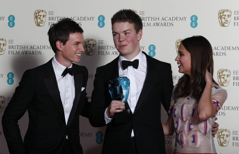 Will Poulter (C) celebrates winning the Rising Star award with Eddie Redmayne (L) and Alicia Vikander at the British Academy of Film and Arts (BAFTA) awards ceremony at the Royal Opera House in London February 16, 2014. (Picture: Reuters)