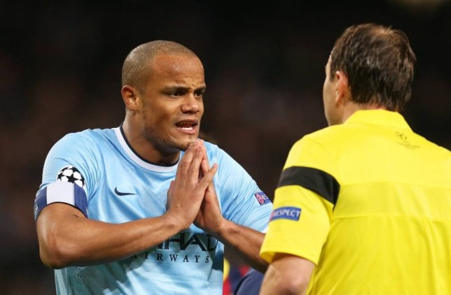 Football - Manchester City v FC Barcelona - UEFA Champions League Second Round First Leg - Etihad Stadium, Manchester, England - 18/2/14  Manchester City's Vincent Kompany (L) talks with referee Jonas Eriksson   Mandatory Credit: Action Images / Carl Recine  Livepic  EDITORIAL USE ONLY.