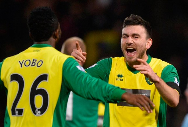 "Norwich City's goal scorer Robert Snodgrass (R) celebrates with teammate Joseph Yobo after defeating Tottenham Hotspur in their English Premier League soccer match at Carrow Road in Norwich, east England, February 23, 2014. REUTERS/Toby Melville (BRITAIN - Tags: SPORT SOCCER) FOR EDITORIAL USE ONLY. NOT FOR SALE FOR MARKETING OR ADVERTISING CAMPAIGNS. NO USE WITH UNAUTHORIZED AUDIO, VIDEO, DATA, FIXTURE LISTS, CLUB/LEAGUE LOGOS OR ""LIVE"" SERVICES. ONLINE IN-MATCH USE LIMITED TO 45 IMAGES, NO VIDEO EMULATION. NO USE IN BETTING, GAMES OR SINGLE CLUB/LEAGUE/PLAYER PUBLICATIONS"