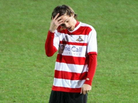 One Direction's Louis Tomlinson makes Doncaster Rovers debut in drab 0-0 draw with Rotherham – spends time playing with his hair