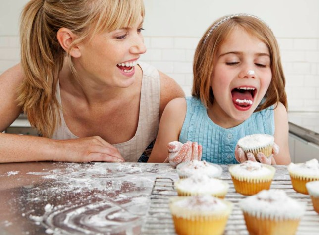 Mum and daughter with cakes. Image by   Fiona Jackson-Downes and Dirk Lindner/cultura/Corbis