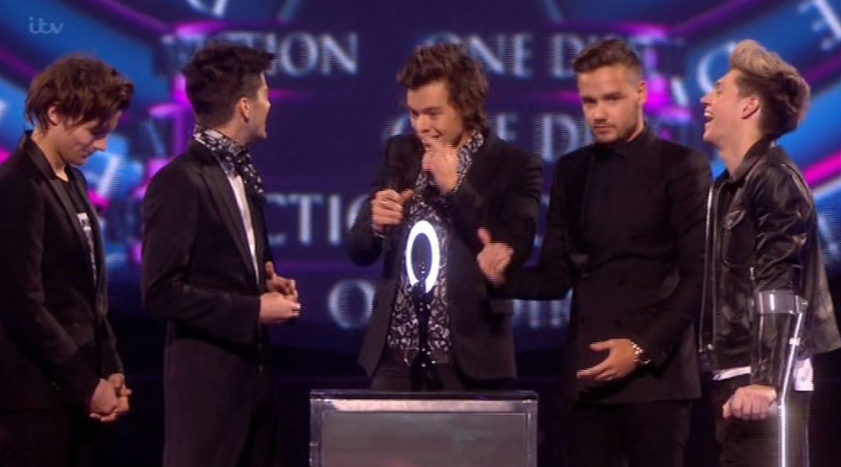 Harry Styles finally shows up on stage (Picture: ITV)