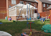 Children's play items in the rear garden at the  home of the Hogan family in Dewfalls Drive, Bradley Stoke, Bristol.