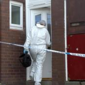 A crime officer enters a house in Beckhill Green, Leeds
