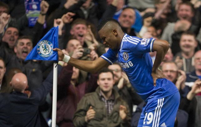 Chelsea's Samuel Eto'o, celebrates after scoring against shoots Tottenham Hotspur, during their English Premier League soccer match, at the Stamford Bridge Stadium in London, Saturday, March 8, 2014. (AP Photo/Bogdan Maran) AP Photo/Bogdan Maran