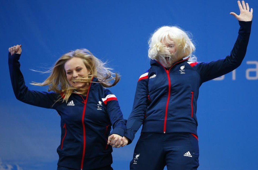 Kelly Gallagher, right, and guide Charlotte Evans celebrate their gold medal (Picture: AP)