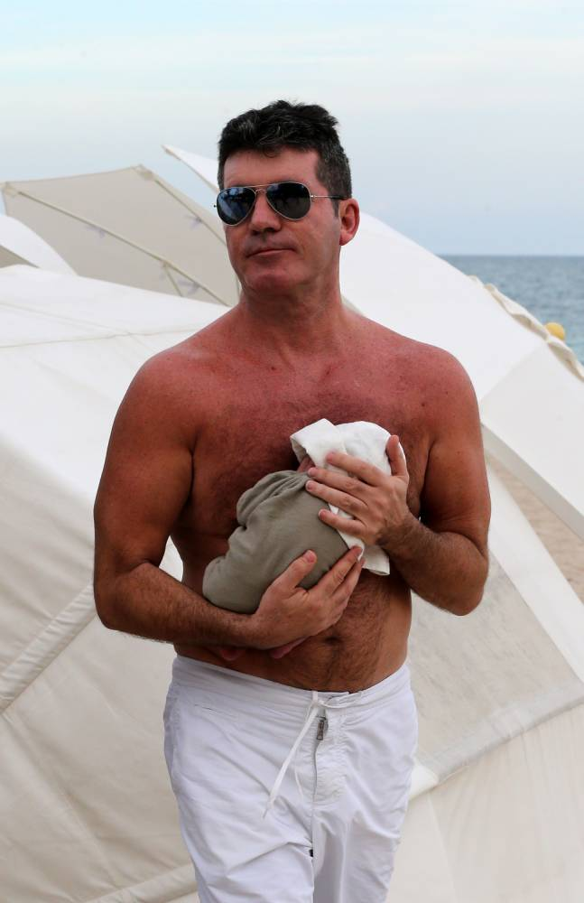 'Eric is well and happy': Simon Cowell takes time out of catching some rays to update eager fans