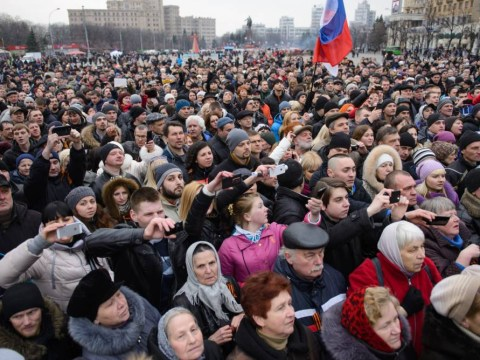 Pictures: Thousands of people on streets in Ukraine as Russia gets involved
