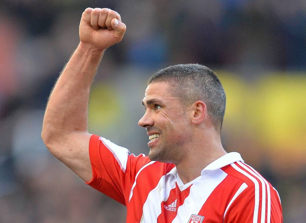 Stoke City's Irish forward Jon Walters reacts as he leaves the pitch after scoring the winning goal during the English Premier League football match between Stoke City and Arsenal at the Britannia Stadium in Stoke-on-Trent on March 1, 2014. Stoke City won 1-0.  AFP PHOTO / ANDREW YATES RESTRICTED TO EDITORIAL USE. No use with unauthorized audio, video, data, fixture lists, club/league logos or live services. Online in-match use limited to 45 images, no video emulation. No use in betting, games or single club/league/player publications.ANDREW YATES/AFP/Getty Images