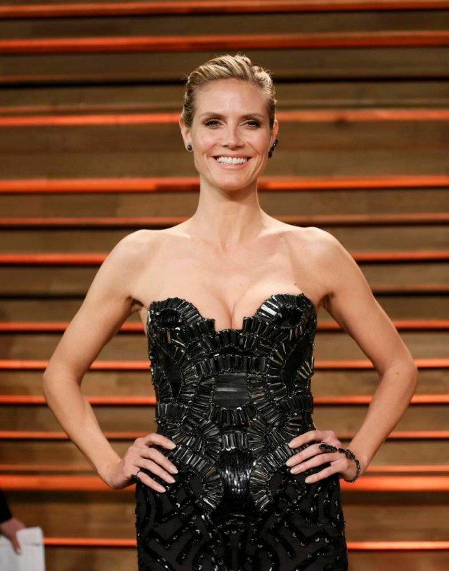 Model and actress Heidi Klum arrives at the 2014 Vanity Fair Oscars Party in West Hollywood, California March 2, 2014. REUTERS/Danny Moloshok (UNITED STATES TAGS: ENTERTAINMENT) (OSCARS-PARTIES)