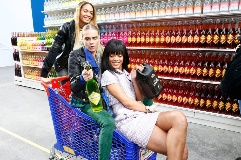 Pictures: Rihanna joins Cara Delevingne and Karl Lagerfeld on bizarre Chanel catwalk show in supermarket during Paris Fashion week 2014