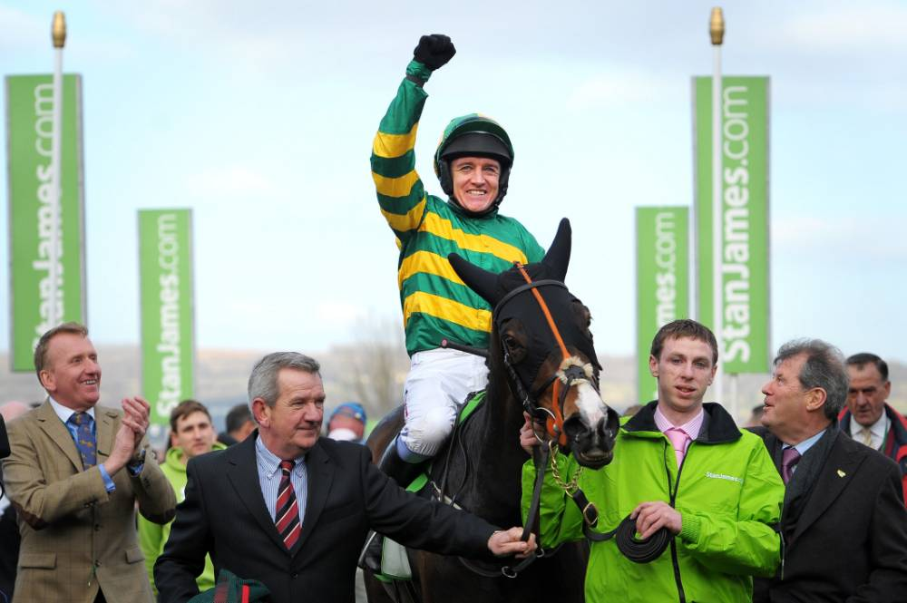 Barry Geraghty on Jezki celebrates winning the Stan James Champion Hurdle on Champion Day at Cheltenham Racecourse, Cheltenham. PRESS ASSOCIATION Photo. Picture date: Tuesday March 11, 2014. See PA story RACING Cheltenham. Photo credit should read: Tim Ireland/PA Wire