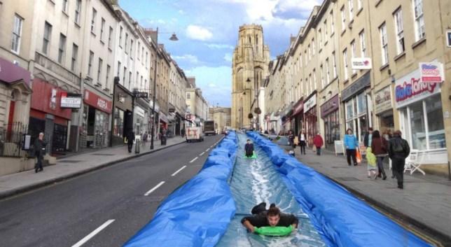 Park and Slide: Artist Luke Jerram brings 300ft waterslide to Bristol's Park Street