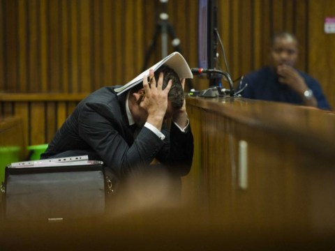 Oscar Pistorius throws up in court again as pictures of Reeva Steenkamp's body shown by mistake