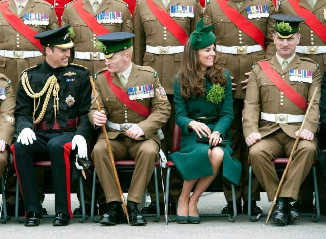Family matters: The Duke and Duchess of Cambridge pose for photographs while visiting the Irish Guards (Picture: AFP/Getty)