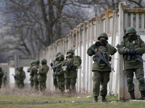 Ukraine's troops to leave Crimea after Russian attack